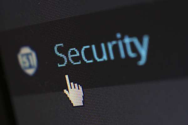 Photo of a computer screen showing the mouse hovering over the word Security