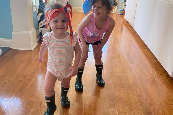 Josie Macchio, right, plays with her sister Isabel Macchio, left