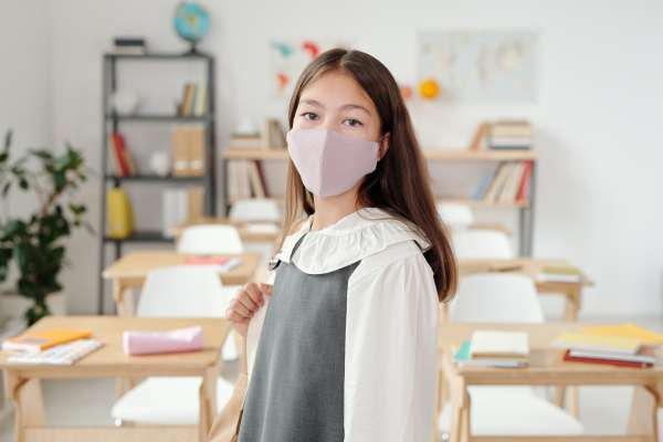 Young student wearing a mask in a classroom