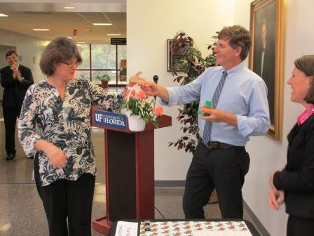 Dr. Rivkees presents Lainey Bertisch with a flower bouquet in recognition of her service to the department.