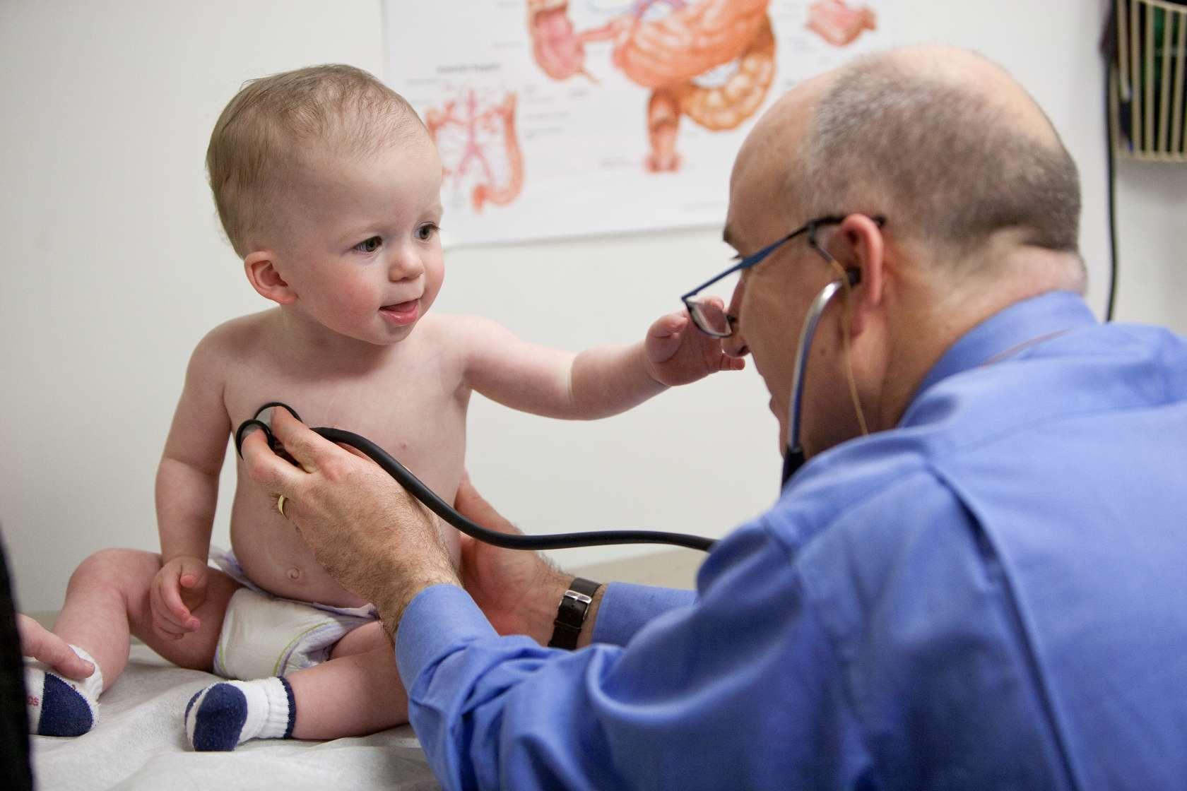 Jim Beau Reinhardt recieves a check up from University of Florida pediatric surgeon David W. Kays, M.D.