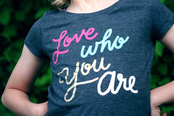 Child wearing Love Who You Are t-shirt