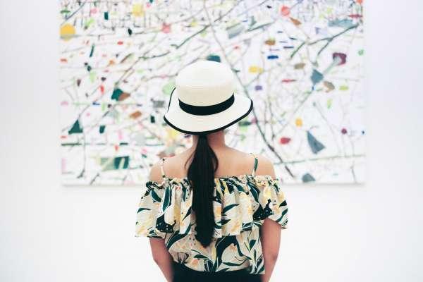 Woman looking at abstract painting